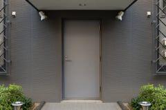 Roll up garage door on brick wall. Old weathered roll up garage door on brick wall stock photos