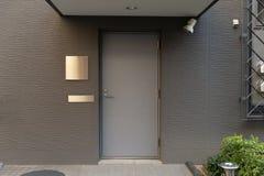 Roll up garage door on brick wall. Old weathered roll up garage door on brick wall royalty free stock photos