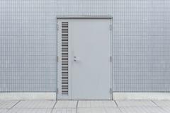 Roll up garage door on brick wall. Old weathered roll up garage door on brick wall royalty free stock image