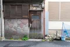 Roll up garage door on brick wall. Old weathered roll up garage door on brick wall stock photography