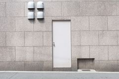 Roll up garage door on brick wall. Old weathered roll up garage door on brick wall stock images