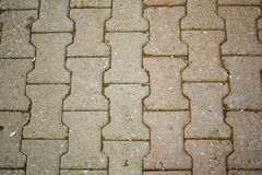 Sidewalk surface. Texture of sidewalk ground of stones. City road Royalty Free Stock Photo
