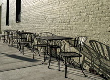 Sidewalk tables and chairs Stock Images