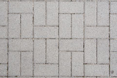 Sidewalk texture. Concrete bricks with symmetrical pattern Stock Images