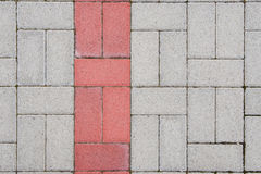 Sidewalk texture. Concrete bricks with symmetrical pattern and red line Stock Image