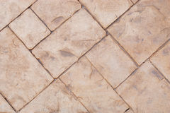 Sidewalk texture detail. Brick sidewall texture in diagonal composition Royalty Free Stock Photo