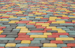 Sidewalk tile brick. Paving tiles colored bricks paved on the street Royalty Free Stock Photography