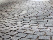 Sidewalk tile. Grey on the European street Royalty Free Stock Photos