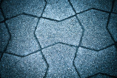 Sidewalk tile made of natural stones. Background. Toned Stock Photos