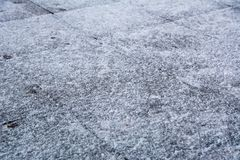 Sidewalk Tiles Covered With Ice And Snow Royalty Free Stock Photos