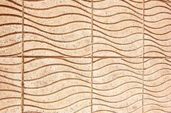 A sidewalk with tiles. A flat or curved piece of fired clay, stone, or concrete used especially for roofs, floors, or walls and often for ornamental work stock photo