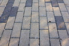 Sidewalk tiles horizontal background picture. Vertical arranged tiles. Small pebbles on top Stock Photo