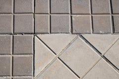 Sidewalk tiles. Sidewalk tile regular colors and geometric shapes Royalty Free Stock Photo