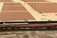Sidewalk under construction. Drainage gutters and waterproofing layers installation Royalty Free Stock Images