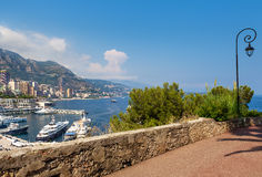 Sidewalk and view on Monte Carlo, Monaco. Royalty Free Stock Images