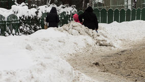 Sidewalk was found. People on street after snow removal at Bucharest, Liviu Rebreanu Street stock image
