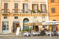 Sidewalk wine bar cafe in the Piazza Navona of Rome, Italy. A sidewalk wine bar cafe in the Piazza Navona of Rome, Italy being prepared for customers and royalty free stock images