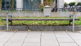 Sidewalk wooden bench in Munich city, Germany. Sidewalk wooden bench in winter in Munich city, Germany Royalty Free Stock Photos