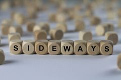 Sideways - cube with letters, sign with wooden cubes Royalty Free Stock Photo