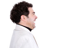 Sideways view of attractive laughing man Royalty Free Stock Images