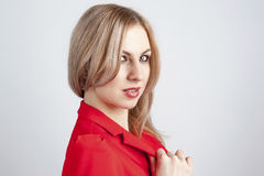 Sideways view of young woman in red jacket Stock Photography