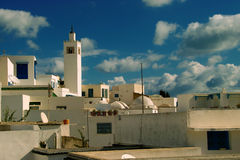 Sidi bou Said/blue and white village. Minaret and typical white houses and blue windows. The town was named after sidi Abou Said ibn Khalef ibn Yahia Ettamini el Royalty Free Stock Photo
