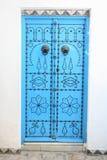 Sidi Bou Said gates. SIDI BOU SAID, TUNISIA - SEPTEMBER 14, 2012 : A detail of blue gates in a typical house in Sidi Bou Said,Tunisia. Sidi Bou Said is a town in Stock Image