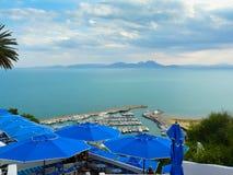 Sidi Bou Said port in Tunisia. Blue umbrellas and port of Sidi Bou Said Royalty Free Stock Images