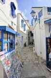 Sidi Bou Said street with shops and blue colors. Postcard shop and souvenir shop. beautiful sunny day, Tunisian art, Sidi Bou Said Royalty Free Stock Photography