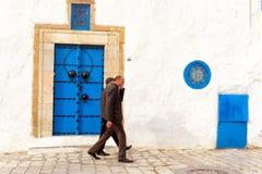 Men Walk in the Medina of Sidi Bou Said, Tunisia stock images