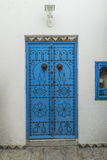 Sidi Bou Said, Tunisia. Sidi Bou Said - Beautiful ornamental blue door of so typical shape for Tunisia stock photography