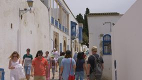 Sidi Bou Said, Tunisia - 06 June 2018: Tourists people walking on narrow street in ancient city. People walking on stock footage