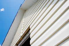 Siding against the sky. Installation of a siding Royalty Free Stock Photos