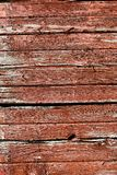 WEATHERED WORN RED BARN WOOD SIDING. The siding of a barn shows the weathered effects of years of rain , snow and wind royalty free stock photography