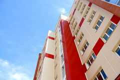 Siding color. Facade of a multi-storey houses with colored siding Royalty Free Stock Photography