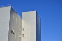 Siding on industrial high-rise building Stock Photo