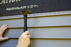 Free Siding Installation Stock Image - 102820441