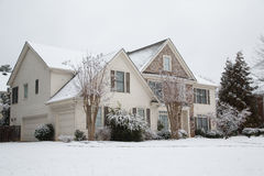 Siding and Stone House in Snow Stock Images
