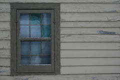 Siding and Window on Old Home. Weathered siding and six over six window on a house dating back to the 18th century stock photo