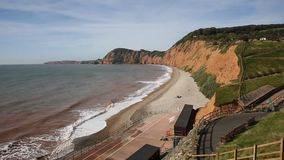 Sidmouth beach and coast Devon England UK to the west PAN stock footage