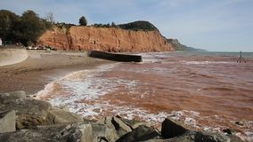 Sidmouth beach coast and waves to the east stock video