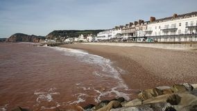 Sidmouth beach and seafront Devon England UK PAN stock video