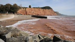 Sidmouth coast and waves Devonto the east PAN stock video