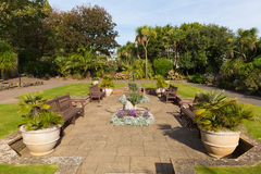 Sidmouth Connaught flower gardens Devon England UK. With seats and potted plants stock images