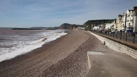 Sidmouth Devon beach waves and hotels stock footage