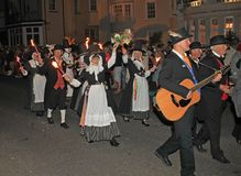 SIDMOUTH, DEVON, ENGLAND - AUGUST 10TH 2012: A group of Welsh performers takes part in the night time closing procession of folk. Week stock image