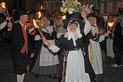 SIDMOUTH, DEVON, ENGLAND - AUGUST 10TH 2012: A group of Welsh performers takes part in the night time closing procession of folk. Week stock photography