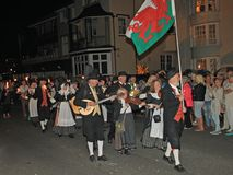 SIDMOUTH, DEVON, ENGLAND - AUGUST 10TH 2012: A group of Welsh performers takes part in the night time closing procession of folk. Week royalty free stock photos