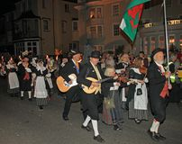 SIDMOUTH, DEVON, ENGLAND - AUGUST 10TH 2012: A group of Welsh performers takes part in the night time closing procession of folk. Week royalty free stock photo