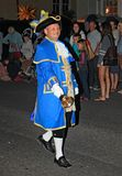 SIDMOUTH, DEVON, ENGLAND - AUGUST 10TH 2012: The town crier leads the night time closing down procession along the Esplanade. The stock images